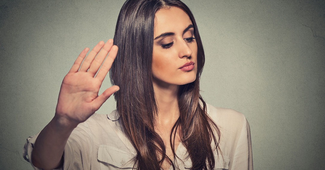 annoyed angry woman with bad attitude giving talk to hand gestur